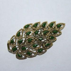 Vintage gold and green leaf brooch